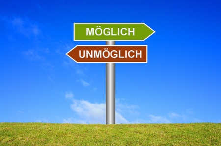 groundbreaking: Signpost sign with blue sky and green grass showing impossible or possible in German language Stock Photo