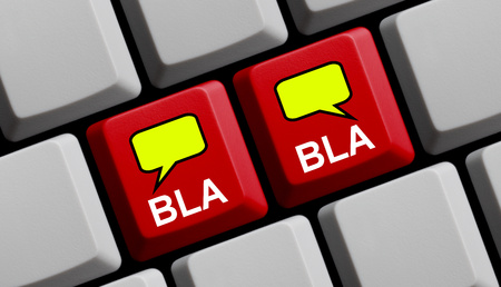 uneducated: Red Computer keyboard with two speech bubble showing bla bla