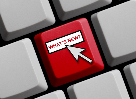 Computer Keyboard with mouse arrow showing Whats new online