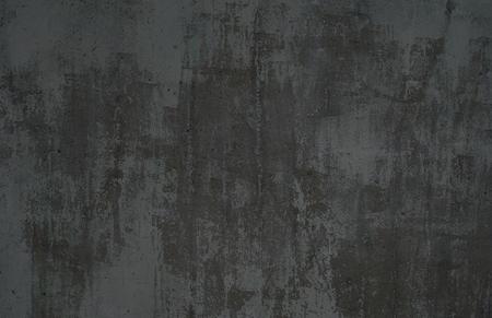 古い灰色の表面の暗いグランジ背景