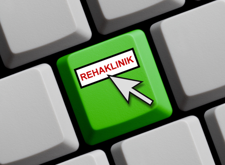 sick leave: Computer Keyboard with mouse arrow showing Rehabilitation clinic online in german language Stock Photo
