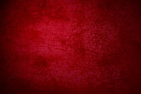 Dark red grunge background of an old surface Standard-Bild