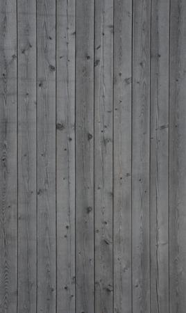pared madera: Foto vertical de un viejo fondo de la pared de madera de color gris Foto de archivo