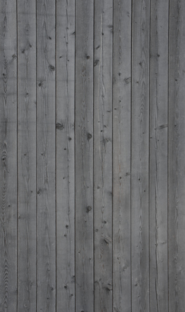 Vertical photo of an old gray wooden wall background Stock Photo