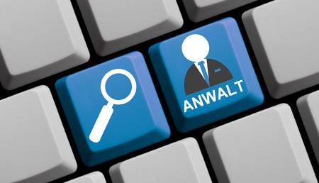 notary: Symbols on Computer keyboard: Searching for lawyers online german Stock Photo