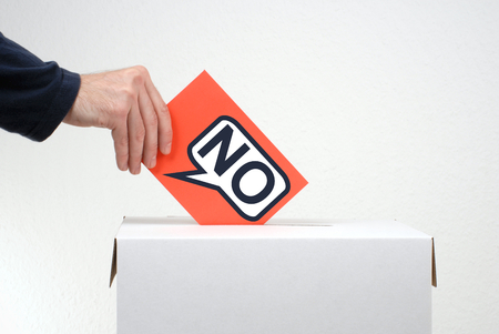 ballot papers: Vote against it - Hand is throwing paper into ballot box