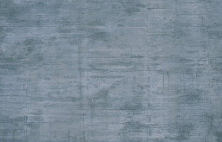 uneven: Urban gray background with uneven scratched concrete wall