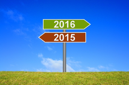Signpost showing year 2015 and 2016 Stock Photo