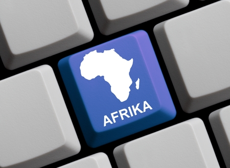computer language: Outline of Africa on a blue computer Keyboard with word in in german language Stock Photo