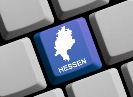 websit: Outline of german federal state Hessen on a blue computer Keyboard