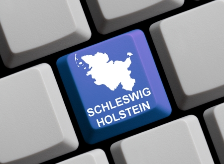 websit: Outline of german federal state Schleswig-Holstein on a blue computer Keyboard