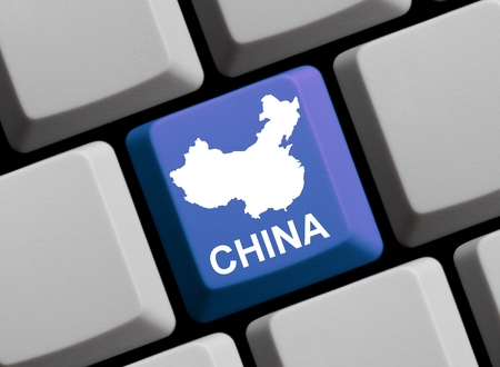 china: Outline of China on a blue computer Keyboard Stock Photo