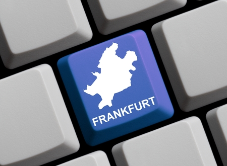 frankfurt: Outline of Frankfurt on a blue computer Keyboard with word in in german language
