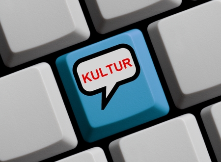 cultural: Blue computer keyboard with speech bubble showing in German Language Cultural