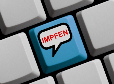 inoculate: Blue Computer Keyboard with speech bubble showing to vaccinate in german language Stock Photo