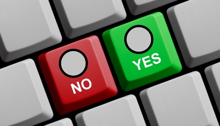 yes no: Computer Keyboard red an green showing yes or no Stock Photo