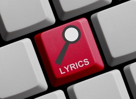 lyrics: Red Computer Keyboard with symbol of magnifier with Lyrics Stock Photo