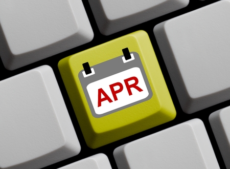 april: Calendar on yellow computer keyboard showing April