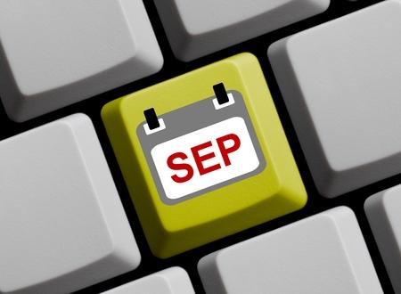 september: Calendar on yellow computer keyboard showing September