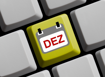 computer language: Calendar on yellow computer keyboard showing December in german language