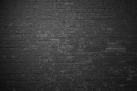 Dark brick wall with grey stones