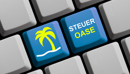 exile: Symbols on blue computer keyboard showing fiscal paradise in german language