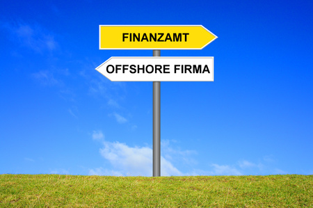 authorities: Signpost showing Tax Authorities or Offshore company in german language Stock Photo