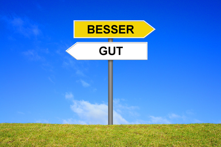 best guide: Sign with two arrows shows Good or Better in german language Stock Photo
