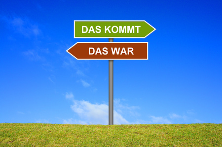 was: Sign with two arrows shows What was What comes in german language Stock Photo