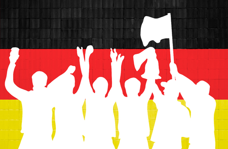 cheering fans: Silhouette of cheering soccer fans in front of wall with german colors