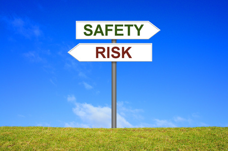 risky: Sign with two arrows shows Safety or Risk Stock Photo
