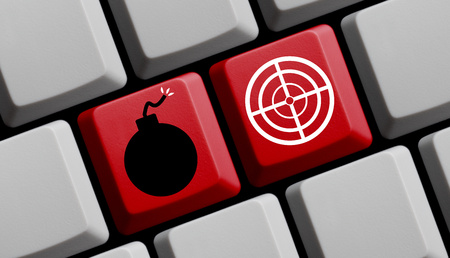 cyber terrorism: Red keyboard with symbol of bomb and reticle - Online Terrorism