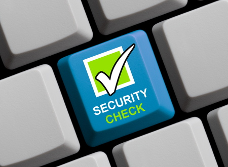 security check: Blue computer keyboard is showing Security Check Stock Photo