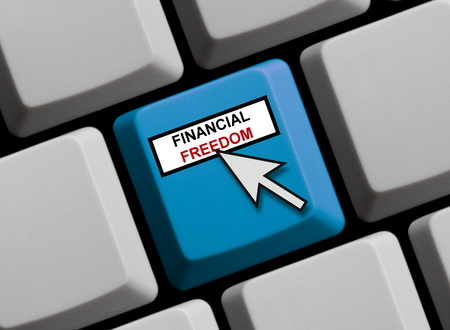 financial freedom: Blue computer keyboard with cursor is showing Financial Freedom Stock Photo