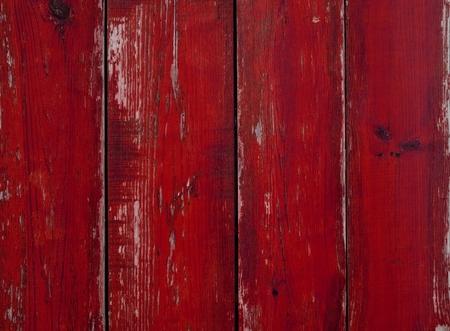 古い風化した赤い板を持つ木製の背景