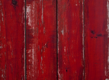 Wooden background with old weathered red planks