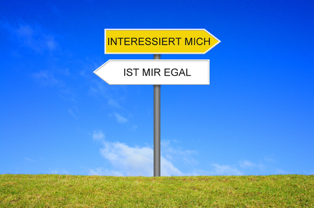 Signpost outside is showing I'm interested and boring in german language