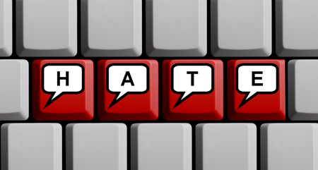 Red computer keyboard showing Hate in speech bubbles Stock Photo