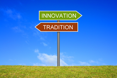 Signpost outside is showing Tradition and Innovation