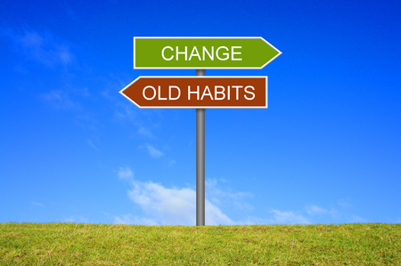 Signpost outside is showing Old habits and Change
