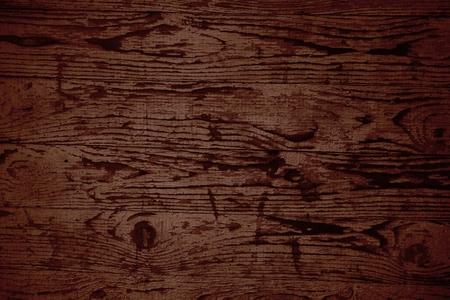 Dark brown wooden board texture background Imagens