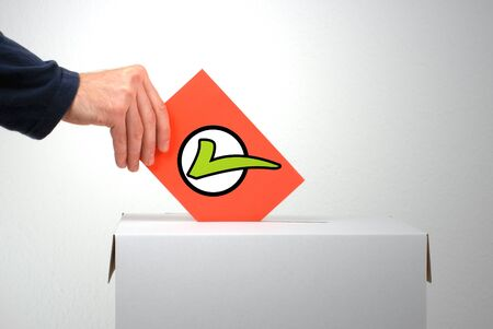Red envelope with green tick with ballot boy and human hand