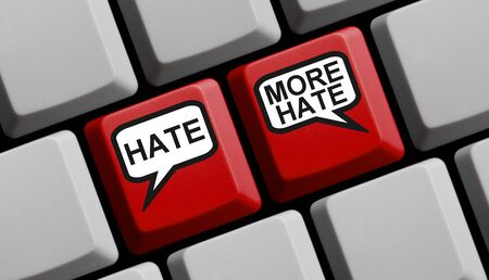Hate and More Hate - Two speech bubbles on red computer keyboard Imagens