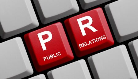 PR Public Relations Concept online on red computer keyboard