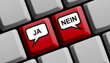 Computer keyboard showing different opinions in german language: Yes or No Stockfoto