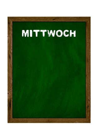 Green wooden board with copy space showing Wednesday in german language with chalk letters