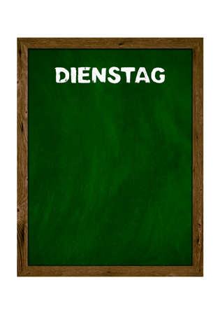 Green wooden board with copy space showing Tuesday in german language with chalk letters