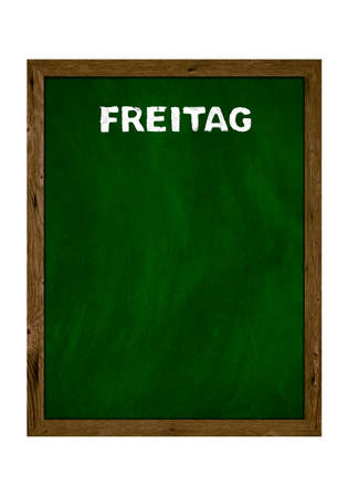 Green wooden board with copy space showing Friday in german language with chalk letters