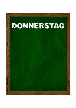 Green wooden board with copy space showing Thursday in german language with chalk letters