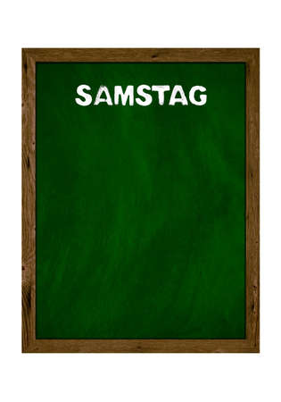 Green wooden board with copy space showing Saturday in german language with chalk letters